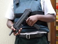 Guard with machine gun