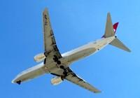Plane is opening its landing g
