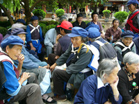 naxi women sitting around