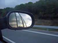 rearview of my car in a rainin