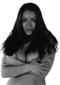 Girl with dark hair & tattoos