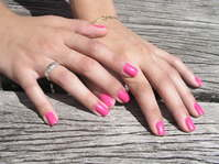 Girl with pink nails