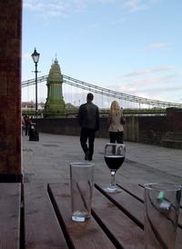 A couple walking along the 'Riverside Walk' in Hammersmith London
