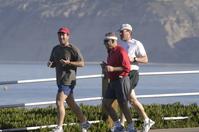 3 men jogging
