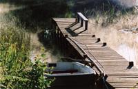 Boat bridge in morning mist