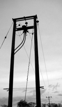 A electric pylon a top a hill