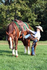 Cowboy Mounting his horse