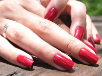 Girl with long red nails