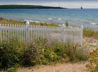 Picket fence on beach
