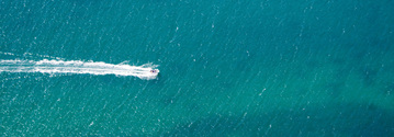 Speedboat across Australian coastline