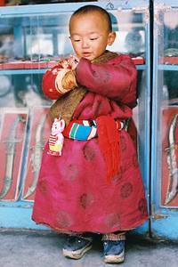 Tibetan boy in traditional cos