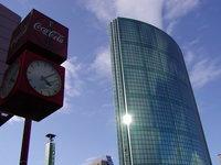 clock&skyscraper in sun