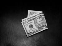 Money on a dark desk 3