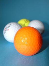Different coloured golf balls
