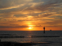 sea sky sun going down 1