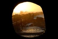 Frail sea defences at dawn