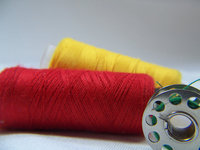 Reel and threads of colors