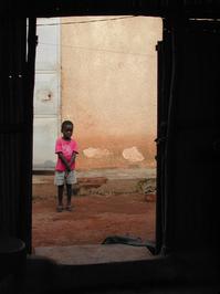 African Boy in Doorway