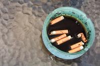 cigarettes swimming in ashtray