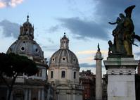 Roman statue cityscape