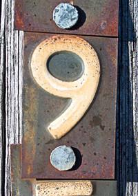 number 9 on metal rusty