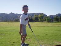 Boy hitting golf balls 5