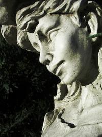 Stone garden angel up close