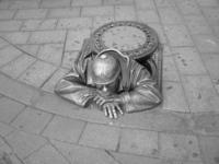 sad man in a hole