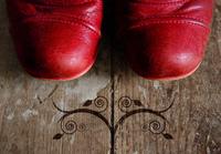 pink boots on grunge western wood floor
