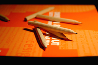 pencils on book's cover (orange)