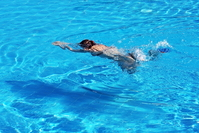 Breast stroke swimming woman