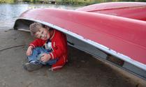 Child in Red Canoe