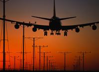 Jet Airplane Landing at Sunset ca. 2000