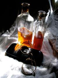 Amber liguid in antique bottle