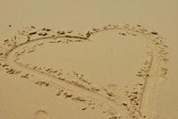 Heart written in sand