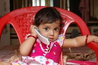 Baby Girl on Phone