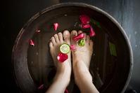 Woman soaking feet at spa