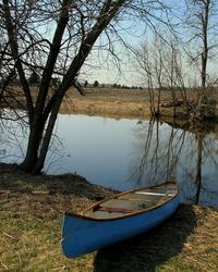 Canoe by water
