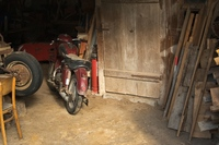 old motorcycle in a barn