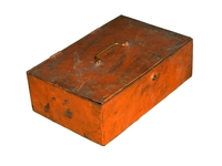 Old orange metal chest