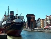 Medieval crane and old steamer