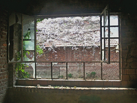 window with view of a ruined roof