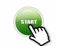 zielony przycisk start i ręka w białej rękawiczce