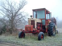 Tractor in Winter Field