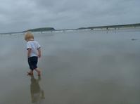 baby on a wet beach
