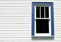 Blue window of old cabin