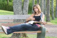 Guitar girl on park bench 1