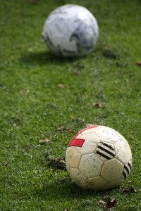 Footballs on lawn