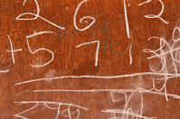 Chalk markings on a rusted sheet