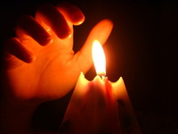 Hand over candle